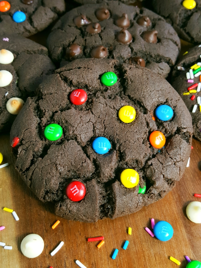 Chocolate Cake Mix Cookies - Big, bakery style cookies made with melted butter. Easy recipe, only 4 ingredients. Add chocolate chips, m&m's, Rolos, and more!