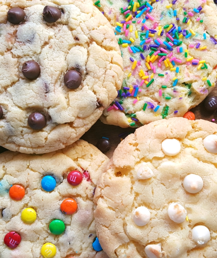 Yellow Cake Mix Cookies 6 Ways - Big, bakery style cookies made with melted butter. Requires only 4 ingredients. Add chocolate chips, m&m's, sprinkles, and more!