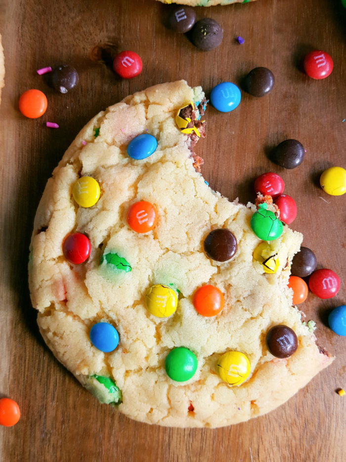Chewy Yellow Cake Mix Cookies 6 Ways - Big, bakery style cookies made with melted butter. Requires only 4 ingredients. Add chocolate chips, m&m's, sprinkles, and more!