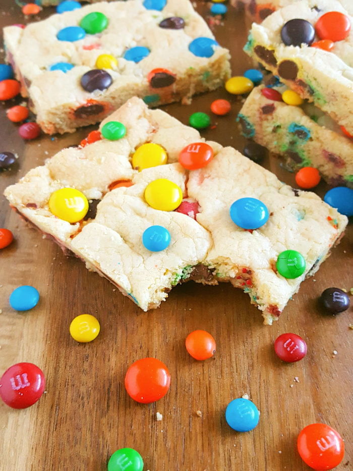 4 Ingredient Chewy M&M's Cookie Bars - Buttery Cookie Bars loaded with crunchy chocolate-y M&M's. An easy one bowl recipe that's ready in less than 25 minutes!