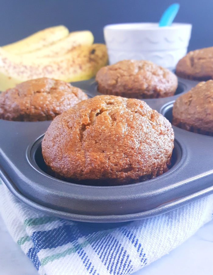 Healthy Banana Applesauce Muffins - Lightly sweetened and made with whole wheat flour. These muffins are oil, butter, and dairy-free! A great alternative to traditional banana muffins.