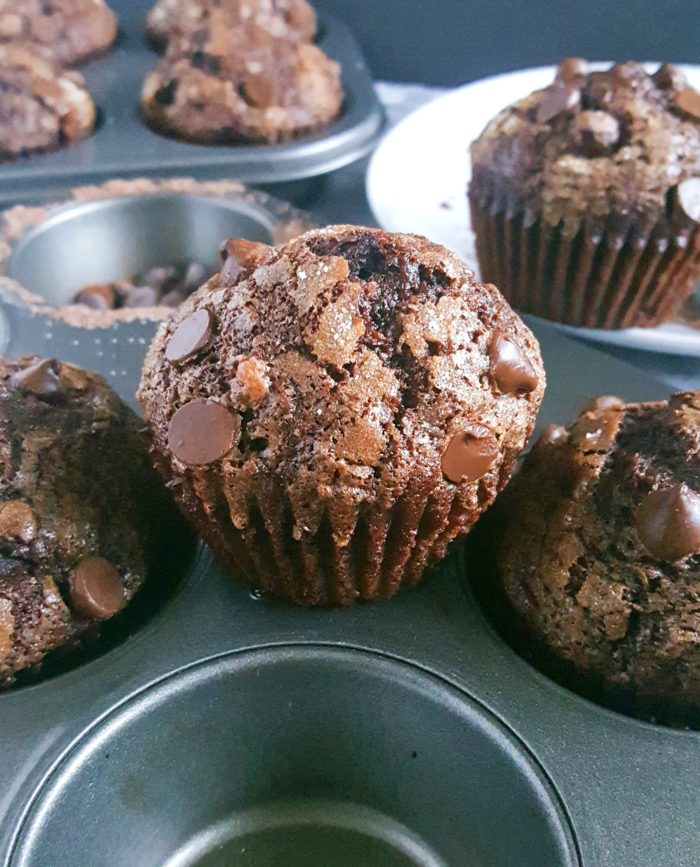 The Best Double Chocolate Banana Muffins - Turn overripe bananas into these Bakery Style Double Chocolate Chip Banana Muffins that taste like Brownies! This is a one bowl recipe that's super easy to make and so delicious.