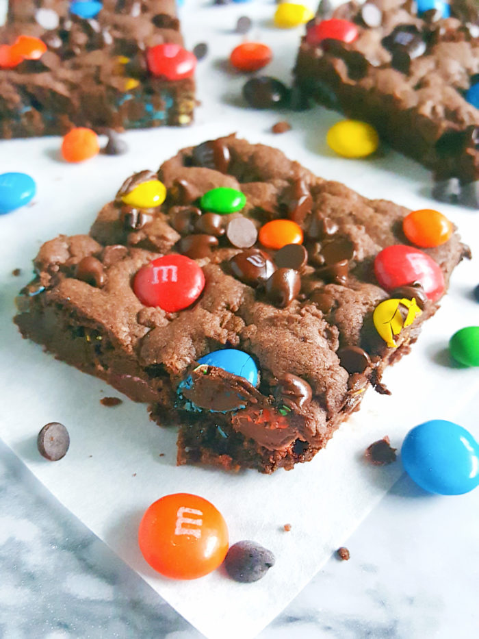 Double Chocolate Chip M&M's Cookie Bars - Rich, soft, and fudgy just like brownie cookies. Filled with melt-y chocolate chips and crunchy candy-coated chocolate M&M's. So easy to make and ready in 20 minutes!