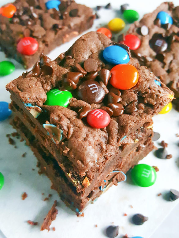 4 Ingredient Double Chocolate Chip M&M's Cookie Bars - Rich, soft, and fudgy just like brownie cookies. Filled with melt-y chocolate chips and crunchy candy-coated chocolate M&M's. So easy to make and ready in 20 minutes!