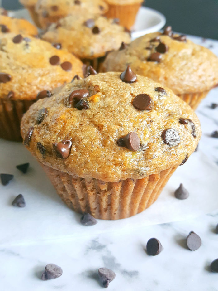 Healthy Greek Yogurt Chocolate Chip Banana Muffins - No butter, sugar, or oil. Moist, low fat, full of fiber, and the greek yogurt adds protein. Made with whole wheat flour, naturally sweetened and studded with chocolate chips for a little indulgence.