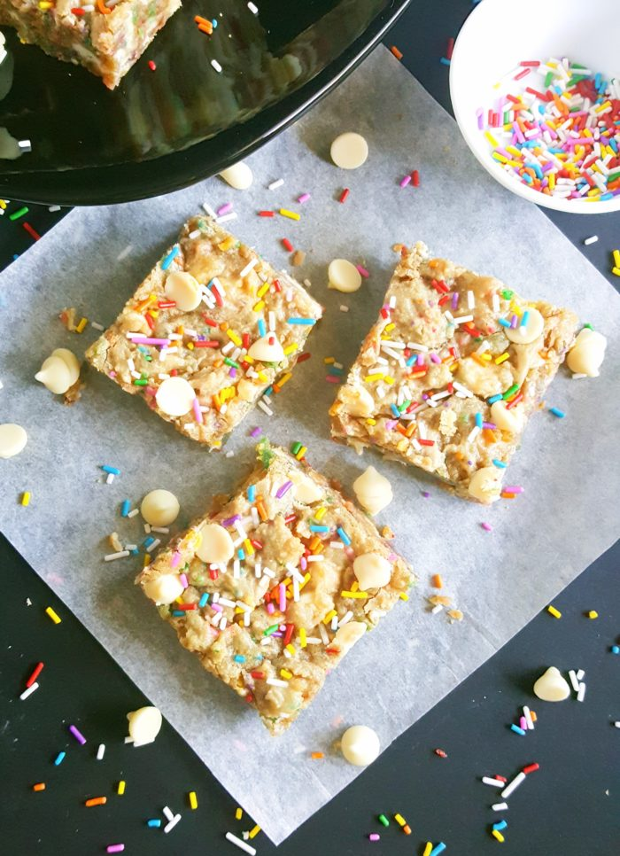 White Chocolate Chip Birthday Cake Batter Blondies - If you love eating cake batter and are a sucker for cookie dough then you will absolutely love these Blondies. No mixer required, one bowl, and they're ready in less than 30 minutes!