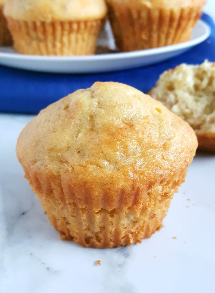 4 Ingredient Cake Mix Banana Muffins - Mix together 3 bananas, 3 eggs, 1/2 cup oil, and 1 box yellow cake mix to make moist and delicious banana muffins! Super quick and easy. | beatbakeeat.com