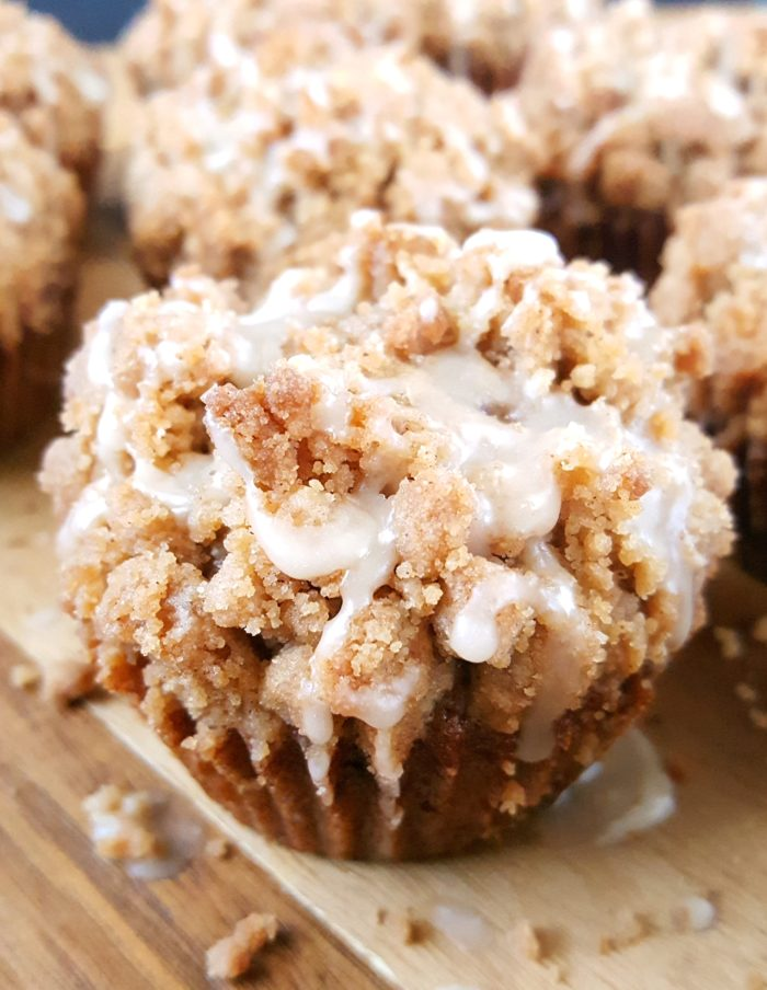 Coffee Cake Banana Bread Muffins - Moist banana muffins with a buttery crumb topping spiced with the perfect amount of cinnamon and drizzled with a creamy vanilla glaze. Another great recipe for using up those overripe bananas.   Beat Bake Eat