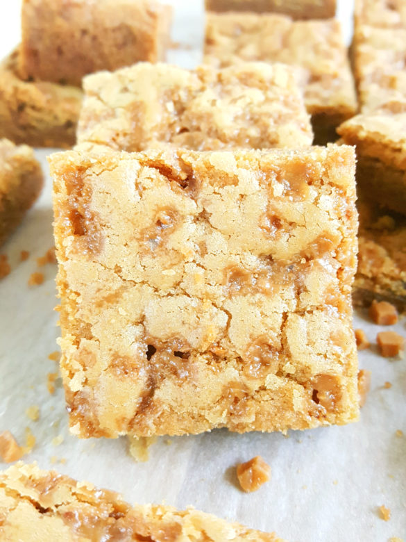 Toffee Bit Cookie Bars - Best soft & chewy, gooey bars packed with brown sugar and caramel flavor. So easy to make and taste like blondies. Grab a 9x13 inch pan and whip up a batch today!   Beat Bake Eat