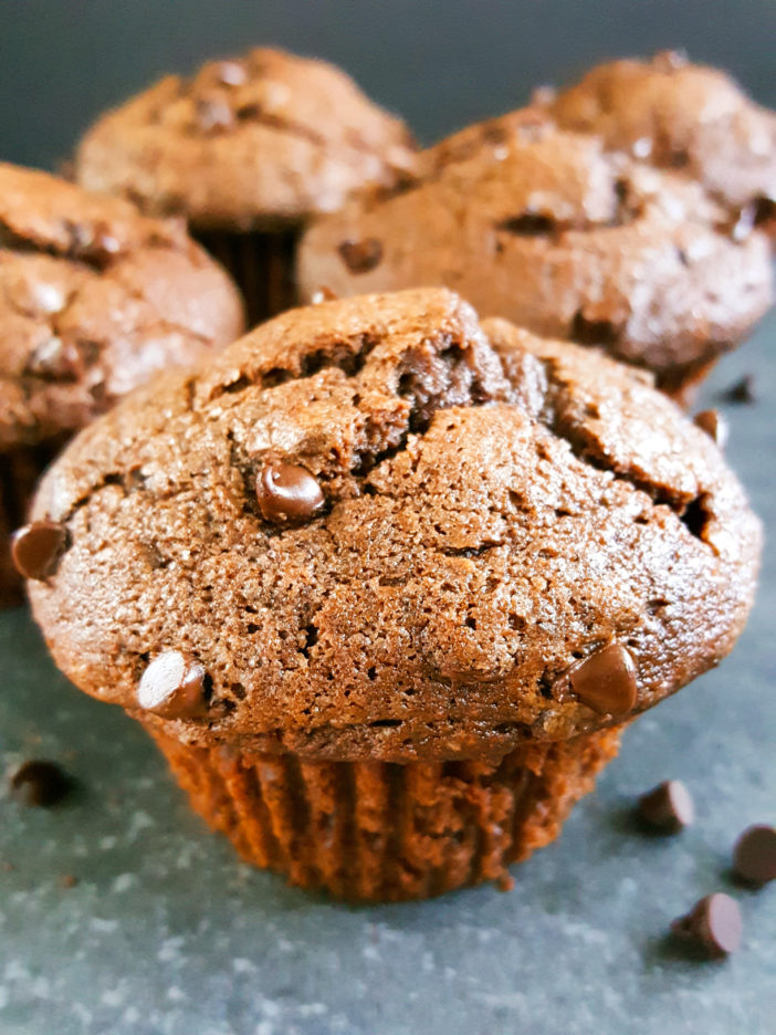 How to make The Best Bakery Style Double Chocolate Chip Muffins - Moist, jumbo chocolate muffins made with butter, sour cream, brown sugar, & cocoa powder. Easy recipe. No mixer. | Beat Bake Eat