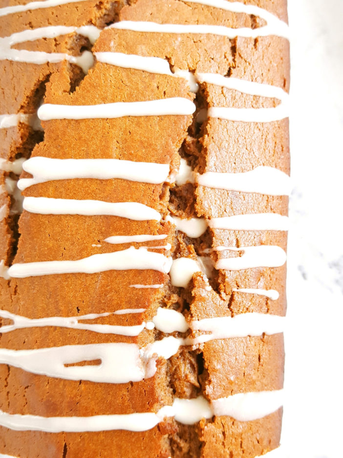 Glazed Sour Cream Gingerbread Loaf - Soft, moist, fluffy, & perfectly spiced molasses bread. This recipe is so simple & easy to make & is one of the best homemade Christmas treats!