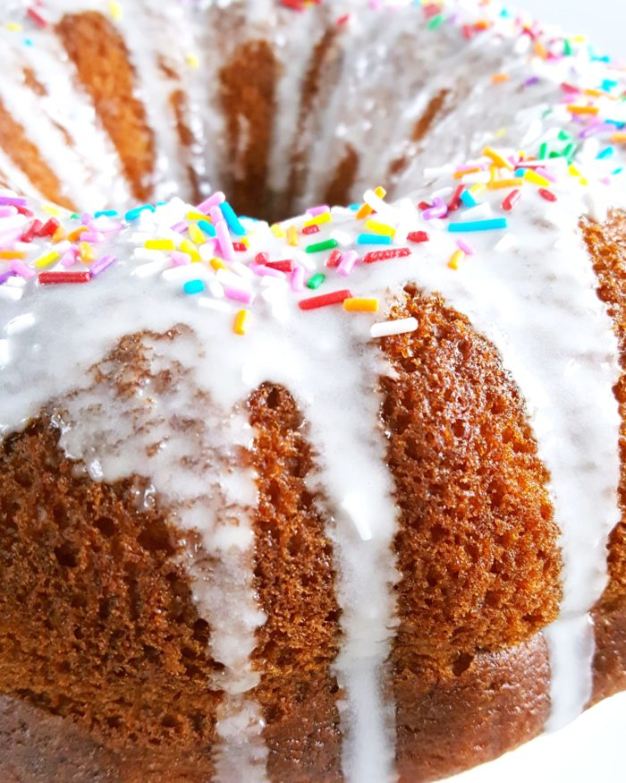 Vanilla Pudding Sour Cream Bundt Cake (Boxed Mix) - Doctored cake mix bundt cake made with sour cream and vanilla pudding. This cake comes out so soft and moist every single time and it tastes like it's homemade! | Beat Bake Eat
