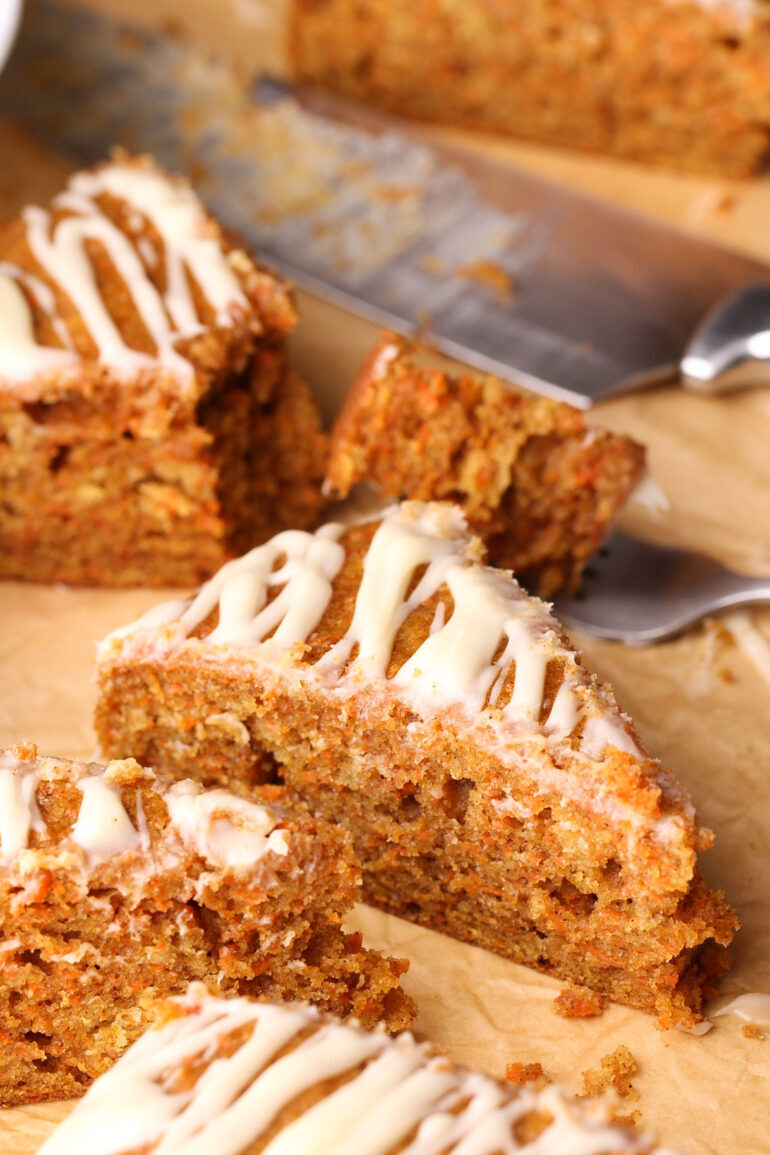 An easy one layer carrot cake made with oil and sour cream and drizzled with a dreamy cream cheese glaze. No mixer needed!   Beat Bake Eat