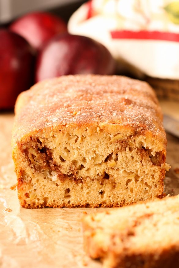 This Apple Quick Bread is topped with cinnamon sugar, has a cinnamon sugar swirl layer in the center, and is perfectly sweetened with plenty of fresh apples. | Beat Bake Eat
